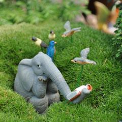 Elephant reading in the garden